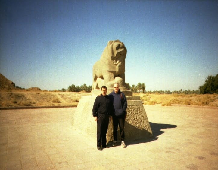 Two people posing in front of a statue Description automatically generated with medium confidence